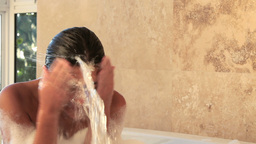Woman spraying her face with water Footage