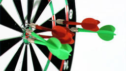 Green and red darts in super slow motion thrown at Footage