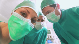 Focus on a surgical team taking off an anesthesia  Footage