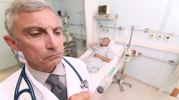 Serious doctor with an injection in his hands in a Footage