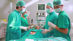 Group of surgeon operating an unconscious patient  Footage
