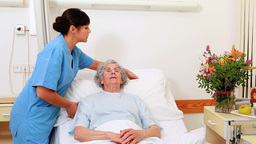 Smiling senior patient talking with a nurse Footage