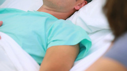 Patient lying on hospital bed Footage