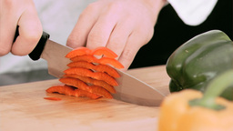 Woman cutting a bell pepper in slow motion Footage