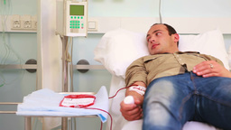 Transfused patient looking the patient next to him Footage