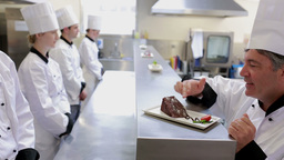 Head Chef Showing New Desert To Chefs stock footage