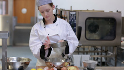 Chef Sifting Flour Into Bowl stock footage