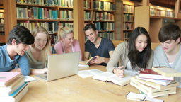 Group of students learning in a library Footage