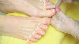 Cosmetician painting toenails Live Action
