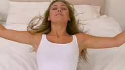 Blonde woman bouncing on her bed Footage