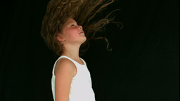 Little girl tossing her hair Live Action