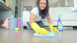 Video of brunette woman scrubbing the living room  Footage