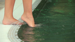Woman wetting her feet Footage
