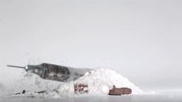 Syringe falling on white drug with pills Footage