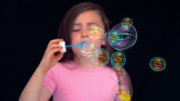 Girl making bubbles in slow motion Footage