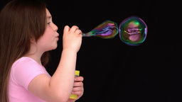 Little girl making bubbles Footage