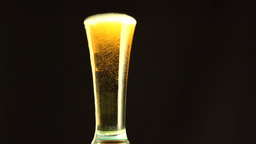 Beer overfilling a glass Footage
