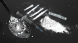 Drops falling on spoon with drug powder Footage