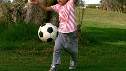 Child playing football Footage