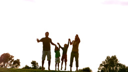 Family jumping in the air Footage