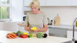 Old woman preparing vegetables Footage