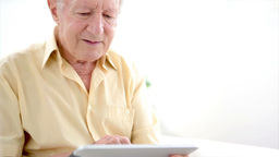 Old man touching a tablet Footage