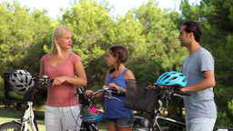 Discussing family with their bikes Footage