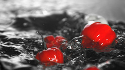 Many chili peppers dropping in water Stock Video Footage