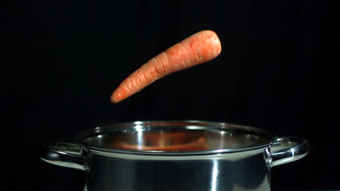 Carrots falling into saucepan Footage