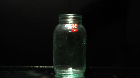 Dice falling into glass jar Live Action