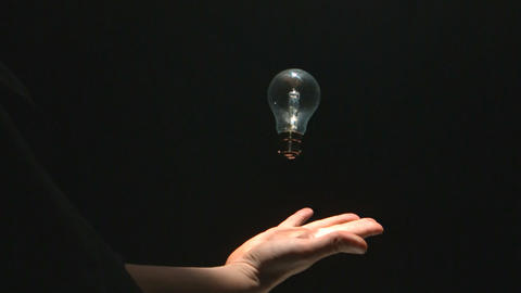 Mans hand catching a bulb Footage