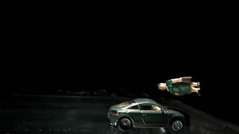 Green toy car crashing into a woman figurine Footage