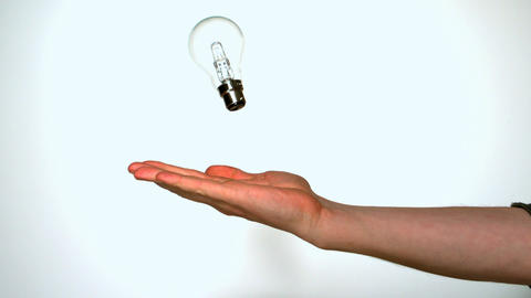 Mans hand throwing light bulb Live Action