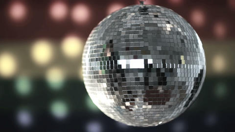 Disco ball spinning against gay pride flag Footage
