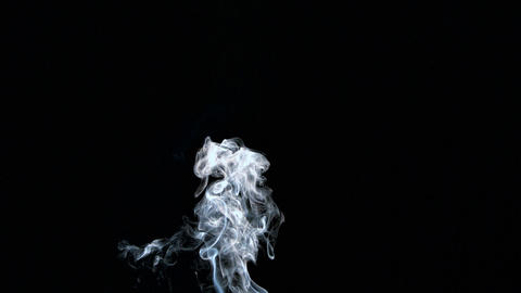 Rising white smoke on black background Footage