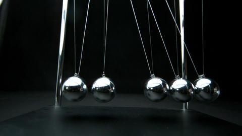 Perpetual motion of newtons cradle Footage