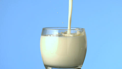 Milk being poured into glass Footage