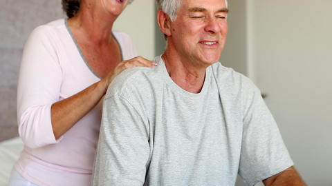 Man enjoying shoulder massage given by his wife Footage