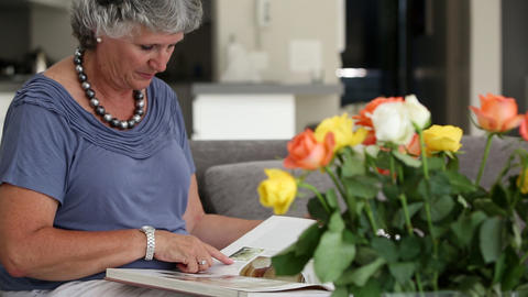 Mature woman reading a book Footage