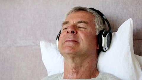 Man moving his head while listening to music Footage
