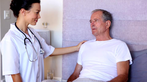 Home Nurse Talking With Patient stock footage