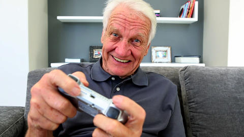Old man playng video games Footage
