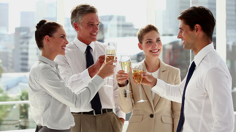 Cheerful business team celebrating with champagne Footage