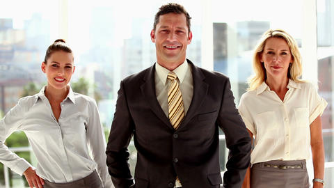 Three smiling business people posing Footage