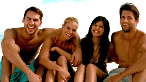 Friends laughing together on the beach Footage