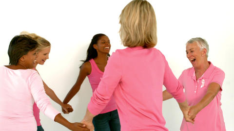 Women dancing in a circle and holding hands wearin Footage