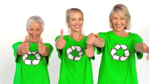 Three enviromental activists giving thumbs up Footage