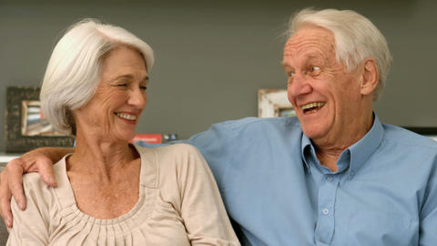Elderly couple laughing in their home Footage
