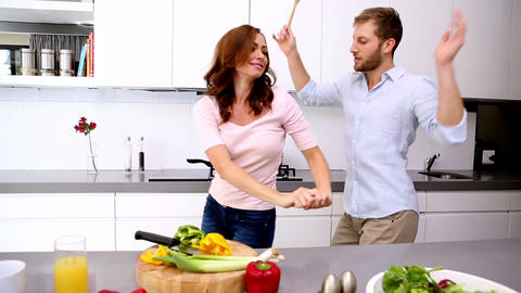 Couple dancing and acting silly in the kitchen Footage