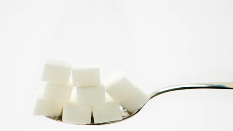 Sugar cubes vanishing from teaspoon Live Action